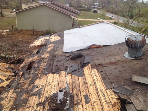 Shingles removed, damage is bad.